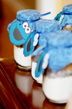 Cookie Monster Party  Cookie in a Jar favors  Logan's First Birthday- A Cookies & Milk feat Cookie Monster Party!  As seen on : HWTM, The Party Wagon, Spaceships and Laser Beans and many more!