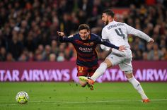 Sergio Ramos of Real Madrid CF battles for the ball with Lionel Messi of FC Barcelona during the La Liga match between FC Barcelona and Real Madrid CF at Camp Nou on April 2, 2016 in Barcelona