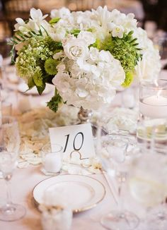 Photographer: Michele Beckwith; Wedding reception centerpiece idea