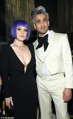 Fashionable friends: : Kelly Osbourne and Tan caught up inside the venue...