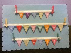 My sister @Bethany made this card for me for my birthday last year.  It's the coolest card I've ever received.  So creative!  Easy bunting birthday card-  cut scrap paper triangles and glue to backside of ribbon  -glued tiny clothes pins (from scrapbooking section at craft store) to paper, and small white letter stickers for message on banner.