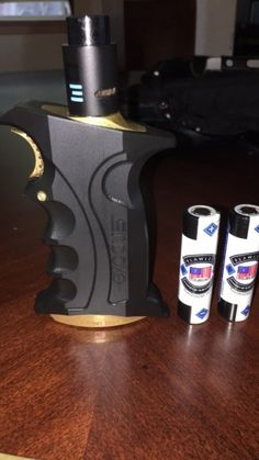 Silver wolf customs Exodus box mod serial 83. w/ black Baal v3 and two sets of flawless batteries. EXODUS grip mod by Silver Wolf Customs Specification Dual 18650 mechanical grip type mod Ma...