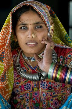 A woman of Kutch in traditional clothes and jewelry, India