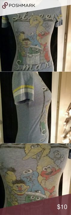 "Sesame Street Characters Tee Shirt Street Smart Sesame Street Characters Tee Shirt size S/P , scoop neck , short sleeve, 25"" long Forever 21 Tops Tees - Short Sleeve"
