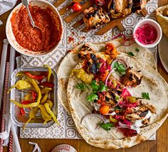 These spicy chicken kebabs can be marinated the day before for extra flavour. Wrap in a warm flatbread and top with pickled chilli and cooling yogurt