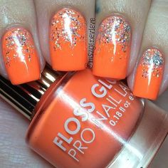 Orange nails with silver hexagon glitter!