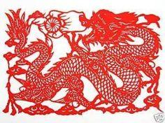 Chinese 剪纸 (jiǎn zhǐ) or paper-cutting