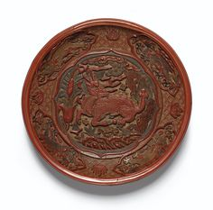 A CARVED RED, YELLOW, GREEN AND BLACK LACQUER 'QILIN' DISH INCISED MARK AND PERIOD OF JIAJING
