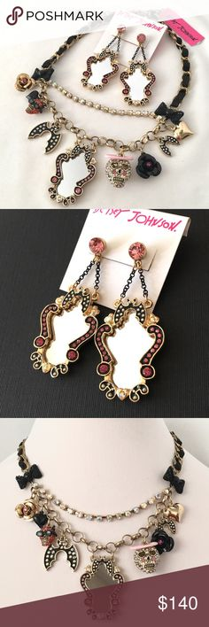 Betsey J 'Angel/Devil' Necklace/Earring Set  RARE! From a delightful past seasonal release. It features the pink haloed angel skull and the sunglasses, earring wearing skull. The earring moves. There are cute bats and those dramatic mirrors!  Very HTF and rare, especially the necklace. NWT, collectible. Perfect for Halloween !  Betsey Johnson Jewelry Necklaces