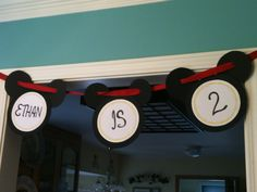 Mickey mouse birthday party sign that I made for Ethan. Love it!!     So easy to make! Just cut out black foam circles, glue the ears on, glue some card stock on the front of the big circle and use your best handwriting skills... And voila!! Oh and cut a slit in each ear for the ribbon to go through. Sooooooo cute!!
