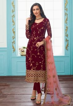 Maroon Color Real Georgette Semi Stitched Salwar Suit Product Details : Fabric of this party wear suit is real georgette. Comes along with a dull santoon inner, bottom and net dupatta. Suit has heavy embroidered work. Suit is semi stitch so you can Designer Suits Online, Designer Salwar Suits, Maroon Suit, Maroon Color, Churidar Suits, Anarkali Suits, Party Wear Lehenga, Salwar Kameez Online, Satin