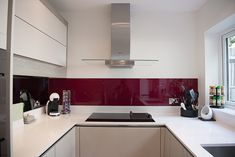 Red glass splashback with white handleless kitchen. Kitchen Projects, Kitchen Splashback Inspiration, Handleless Kitchen, White Worktop, Silestone Worktop, Bespoke Kitchens, Kitchen Collection, Kitchen Design, Smart Kitchen