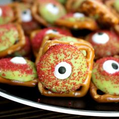 These Zombie Eyeballs Pretzels are the epitome of easy and fun! Waffle pretzels Wilton candy melts – carmel apple flavor Red sanding sugar Candy eyeballs (they have them at Michaels and Target)