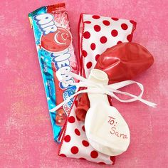 Candy and Balloons Valentine  Wrap a long piece of candy, such as Air Heads or Laffy Taffy, with a wide ribbon. Instead of adding a gift tag, write your valentine's name and a short message on a balloon. Tie the balloon to the treat for a sky-high memento.
