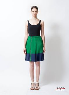 - Louis Vuitton green and blue pleated skirt - Silver-tone side zipper closing - Interior snap and hook closure - Blue band across hemline - Sits at waist - Elastic waistband - 49% Silk, 44% Viscose, 7% Polyamide - Bottom Lining: 100% Silk