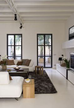 """White polished concrete floors - love this look, and so easy to switch out colors using accessories, etc. But ha, this pic drives me nuts, because of the upturned corner of that rug. Can we say """"perfectionist""""? :D"""