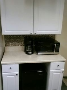 Our basement kitchenette! Completed ( from bare wall to this ) in three hours. $600 does not include appliances. 4' wide. Frig underneath, faux tin as backsplash + Cabinets, countertop, hardware all from Home Depot. Foam floor tile (gray) from Harbor Freight changed concrete to cozy underfoot. ~DIYgirl