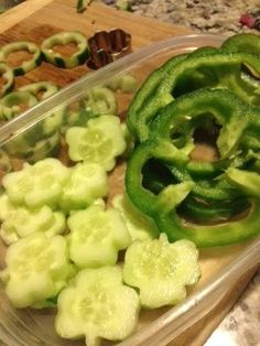 Cookie cutters aren't just for shape cookies! Enjoy a healthy shamrock snack of cucumbers and sliced  bell peppers.