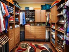 For those who share their space with that special someone, this master closet is divided down the middle for his and her peace of mind. Her side features extra shoe storage while his side makes the most of hanging rods. Photo courtesy of ClosetMaid