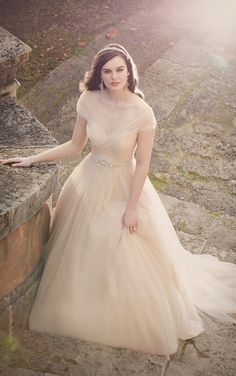 This A-line wedding dress from Essense of Australia flatters all figures with strategic & elegantly placed tulle along the bodice to create a slimming and romantic fit.