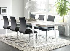 Rustic Spisebord - Rustic spisebord i hvid olieret vildeg. Det enkle bord er støttet af hvide metalben. Flot og lækkert bord til spisestuen. Bordet er råt, stort og voldsomt - designet til mennesker, der holder af at udfolde sig uden begrænsninger, og som lever intenst i nuet. Bordet er fremstillet af tykke planker af massivt egetræ med naturlige revner og sprækker. De bliver båret af en flot jernkonstruktion, der er smedet sammen på en måde, så alle spor af smedeprocessen er bibeholdt fuldt…