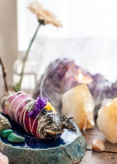 California sage 6 inch smudge stick wrapped with fragrant lavender, dried roses and other flowers. Burn as to cleanse your crystals or display as tabletop d_cor