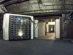 The 25-ton North blast door in the Cheyenne Mountain nuclear bunker is the main entrance to another blast door (background) beyond which the side tunnel branches into access tunnels to the main chambers. (Credit: Wikimedia Commons)
