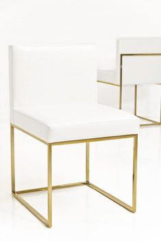 Dining chairs with brushed gold detail