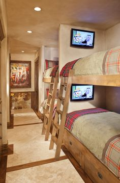 Bunk bed heaven for the kids! give each kid his own TV, drawers. Add inset bookcase, privacy curtain, and lamp per bunk.