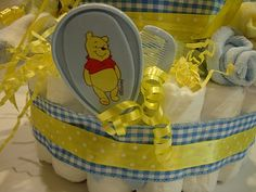"""Shabby Tea Party: Diaper Cake Tutorial - she included baby items in/on the """"cake"""""""