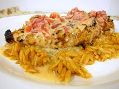 Queso Smothered Chicken   Just made this and it was DROOL worthy...I added a little more chicken stock and cayenne pepper to the orozo and did a sauteed onion and red pepper topping....SOOOOO GOOOD!!!