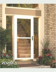 This beautiful entrance is served by the white Screen Away storm door with .This beautiful entry appears through the white Screen Away storm door with . StormDoor Beautiful door entry Impact This beautiful entry gets Black Screen Door, Fly Screen Doors, Aluminum Storm Doors, Aluminium Doors, Double Storm Doors, Larson Storm Doors, Front Door Monogram, Wreaths For Front Door, Door Wreath