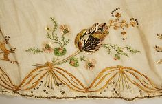 Dress (detail of embroidery at hem), ca. 1810, French, cotton; silk.  In The Metropolitan Museum of Art collection. (Pictures of more details and full dress available on the museum website.)