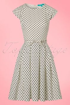 A true vintage romance this 50s Mary Dots Prom Dress!This beauty is inspired by the classic prom-dresses from the fifties with her classy round neckline, box pleats and cute bow belt! Made from a flowy and breezy, ivory white fabric (doesn't stretch!) featuring a playful polkadot print and is fully lined for a perfect fit. The perfect dress to wear to a high-tea with your girls or a summer party, LOVE!   Semi-swing style Round neckline Short sleeves Detachable fabric belt Smocki...