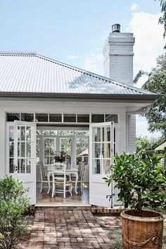 the exterior white French doors lead to an antique French dining table and chairs in this restored Georgian home in western Sydney. Style At Home, French Style House, Country Style Homes, French Dining Tables, Dining Table In Kitchen, Farmhouse Style Bedrooms, French Bedrooms, Double Bedroom, Boho Home