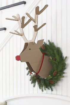 """Create this playful reindeer project with a couple of corrugated cardboard boxes and our handy template .Print out templates on 11x17"""" paper. Trace the head twice, and the antlers once on corrugated cardboard (we purchased flat boxes from Staples). Cut out two head patterns. On the inside of each head pattern, score along the dotted line as shown on the pattern. To score, use an xActo knife to cut partially through the cardboard, which allows the cardboard to fold easily along that line…"""