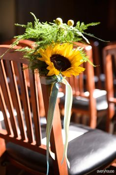 Ceremony chair decor with sunflowers by Fleur, photo by Avery House