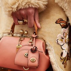 http://www.revelist.com/style-news/coach-handbags-price/7693/To advance its newfound status as a high-end luxury brand, Coach may be acquiring Jimmy Choo, Kate Spade, and Bally, according to WWD./3/#/3