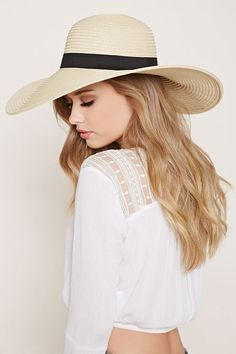 A floppy straw hat with a wide brim and a grosgrain ribbon band. Simple  Dresses c7206f5c983a