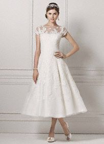 Take short and sweet to a whole new level in this lace cap sleeve tea-length wedding gown.   Picture perfect for an outdoor wedding or reception dress.   Short gown features illusion neckline and beaded lace appliques.  No train. Sizes 0-14. Available online and in stores in Ivory. Available for special order in White.   Fully lined. Back zip. Imported. Dry clean only.  Woman: 8CMK513, Sizes 16W-26W (Special order only),  .  To preserve your wedding dreams, try our ...