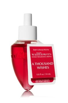 A Thousand Wishes Wallflowers Fragrance Refill - A dazzling blend of pink Prosecco, crystal peony & gilded amber