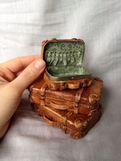 Altoid tin suitcase: Repurposed Altoid box covered in polymer clay. Up cycled zippered pouch material inside, by Amanda Klish.