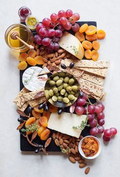 A cheeseboard is the ultimate for when you're entertaining during the festive season! Amazing Food Platters, Party Food Platters, Food Trays, Cheese Platters, Charcuterie Recipes, Charcuterie And Cheese Board, Cheese Boards, Tapas, Appetizers For Party