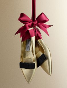 We retouched the cover for Vogue's Christmas Wrapped Up supplement, Dec 2014. - Jimmy Choo gold heels hanging in a big bow