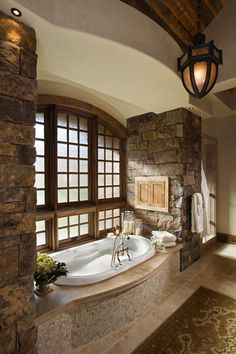 Lovely stone in the bathroom, look at those windows and light fixtures!