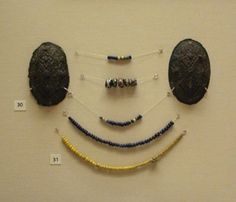 Glass beads and brooches. 9th cent, Norway.  Photo credit - British Museum