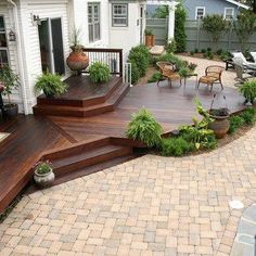 This ground level hardwood deck is just part of this little paradise very close to a busy road. The pool, firepit, grilling area and fencing all around makes this backyard a perfect site for parties. #backyarddesign