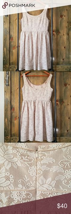 Antonio Melani Dress This very nice cream dress has an overlay of lace, it has a waist with pleated A-line, sleeveless, no rips or stains, has lining inside that looks like Silk or satin,  size 10 ANTONIO MELANI Dresses