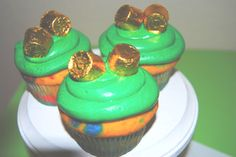St. Patrick's Day Lucky Gold Rainbow Cupcakes - What a fun and festive dessert to celebrate St Patrick's day with the kids!