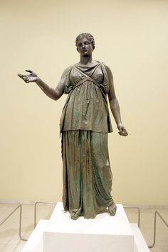 Piraeus Artemis A. Found in 1959. Both Artemis statues are thought to be Hellenistic due to the hairstyle and stance, and both show a full-bodied Artemis with a long skirt that covers her legs. While the Artemis A figure is similar to the others in the collection and larger than life, the Artemis B statue is somewhat smaller than life-size. Archaeological Museum of Praeus in Athens.